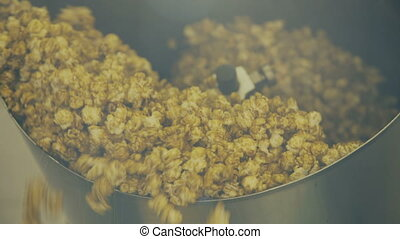 Close up of stirring popcorn in bowl on the factory 4K