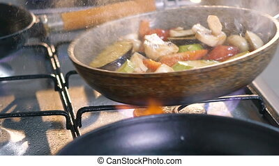 Close up of stirring vegetables on frying pan with oil. Slowly