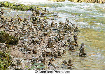 Close-up of stone statues in the water
