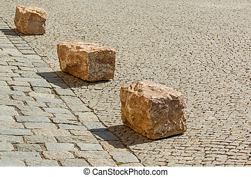 Close-up of stones on old road in the city