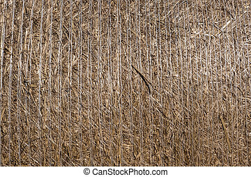 Close-up of straw bale drying on a sunny day.