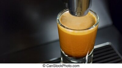 Close-up of strong espresso making at exclusive coffee machine