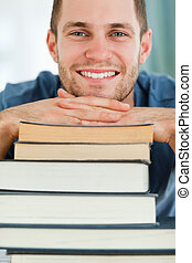 Close up of student with a pile of books
