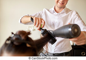 close up of stylist making hairdo at salon - beauty, ...
