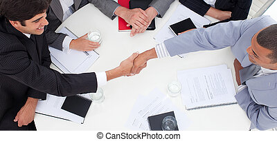 Close-up of successful business people closing a deal