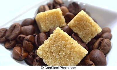 close up of sugar cubes with coffee