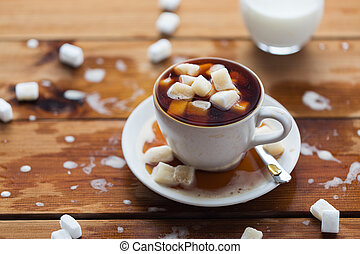 close up of sugar in coffee cup on wooden table