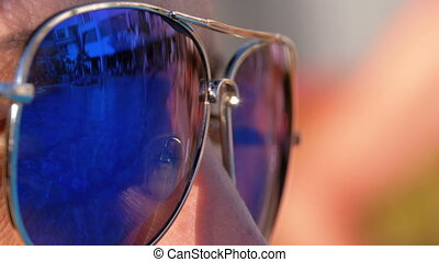 Close-up of Sunglasses on the Face of the Girl and the...
