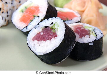 close up of sushi laying on green plate