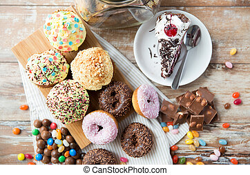 close up of sweets on table - junk food, culinary, baking ...