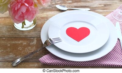 close up of table setting for valentines day - valentines...