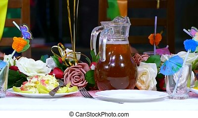 close-up of table with food cafe restaurant birthday jug of...