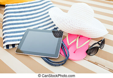 close up of tablet pc on beach