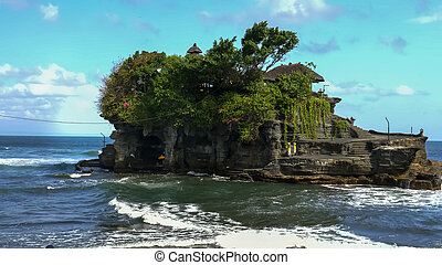 close up of tanah lot temple at high tide