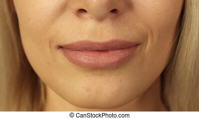 Close-up of teeth and lips of beautiful girl