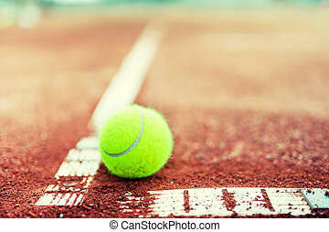 close-up of tennis ball on the court