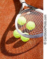 Close up of tennis racket and balls
