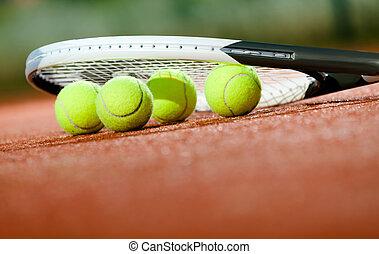 Close up of tennis racquet and balls