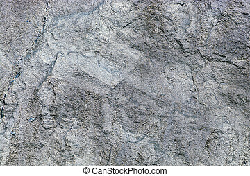 close up of texture of a gray stone wall
