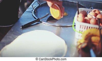 Close up of thai hands making banana pancake on the street...