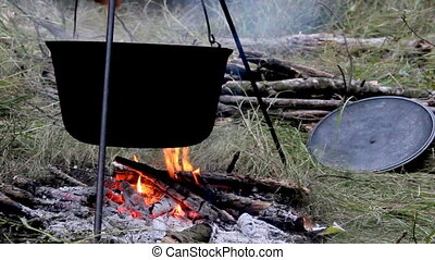 cauldron on campfire - close-up of the black cauldron on...