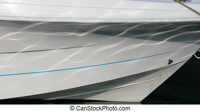 Close up of The Bow of a Boat With Water Reflections