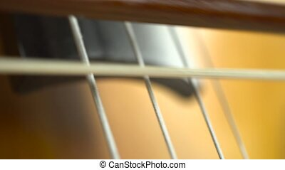 Close up of the bow touches the strings on the cello...