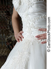 Close-up of the bride's dress with a beautiful pattern