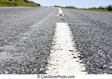 close up of the centre white line of a road