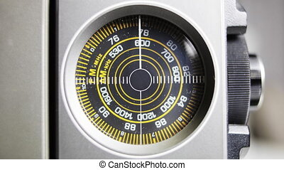 Close-up of the circular radio dial of an old retro radio