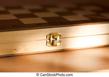 close up of the clasp of a wooden chest