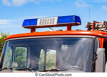 Close-up of the Flashing Blue Siren Light on roof of red firetruck