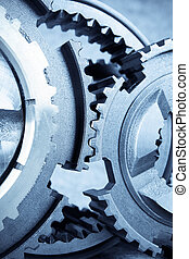 gears meshing together - close up of the gears meshing...