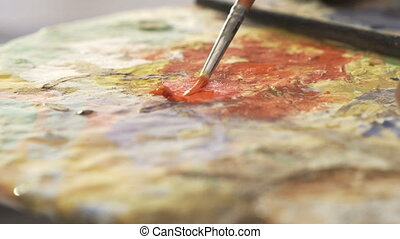 Close-up of the hand of the artist who enjoys board