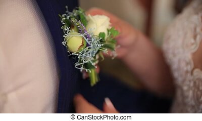 Close-up of the hands, bridesmaid, wearing a boot-yanker at the wedding party