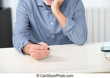 close up of the hands of senior man with pencil
