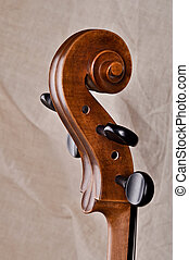 Close up of the head of a violoncello