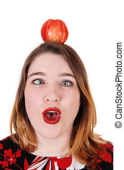 Close up of the head of a woman with an apple