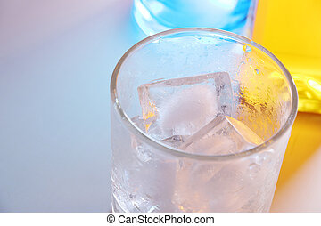 Close up of the ice cubes in glass background
