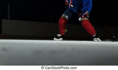 Close-up of the puck is on the ice and in slow motion hockey...