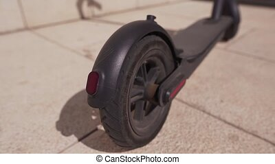 Close-up of the rear black wheel of an electric bike. Alternative transport, eco friendly 4k