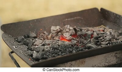 Close-up of the red-hot metal that is get out from the smoldering coals
