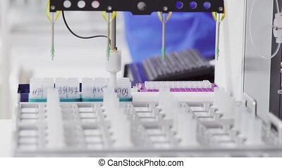 Close-up of the robot in the laboratory injects the drug catalyst for analysis into the test tube