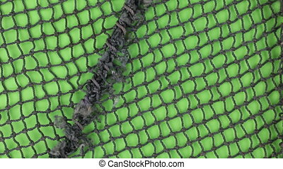 Close-up, of the rotation of a fishing net with seam....