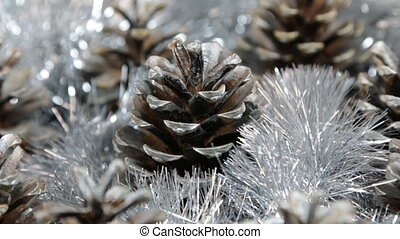 Close-up of the rotation of silver tinsel and silver pine...