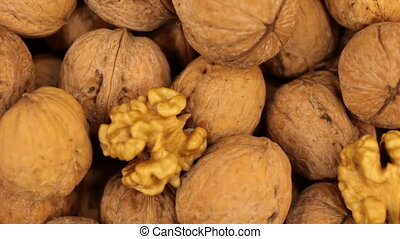 Close-up of the rotation of the background made from walnuts...