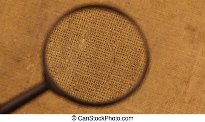 Close-up of the rotation of the burlap cloth under the magnifying glass.