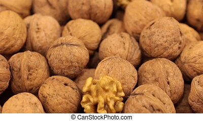 Close-up of the rotation of walnut fruit.