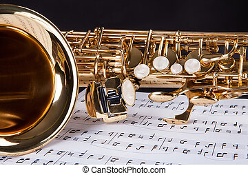 Trumpet And Musical Note - Close-up Of The Trumpet And...