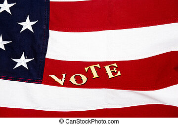 Close up of the USA flag with letters vote staggered